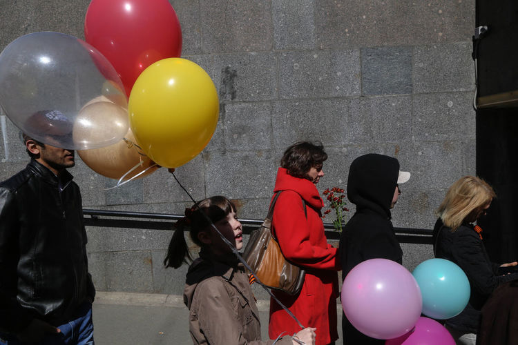 People looking at balloons