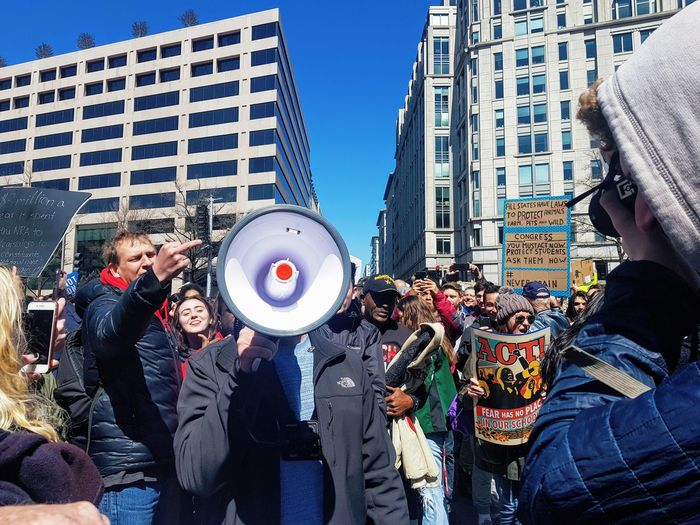Pro-life supporter shouted down at the March For Our Lives in Washington, DC. City City Street DC Protest Washington, D. C. Crowd Demonstration Group Of People Gun Control Guns March March For Our Lives Nra Street