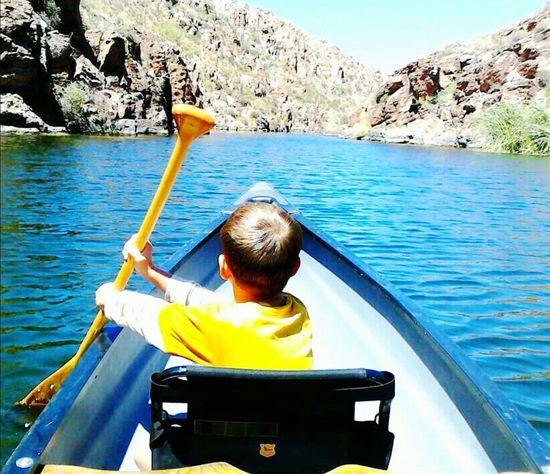 Canyon Lake, AZ Canoe Boy Rear View Nautical Vessel One Person Yellow Water Lake Outdoors Kayak Mountain Nature Leisure Activity Day Sitting People Oar