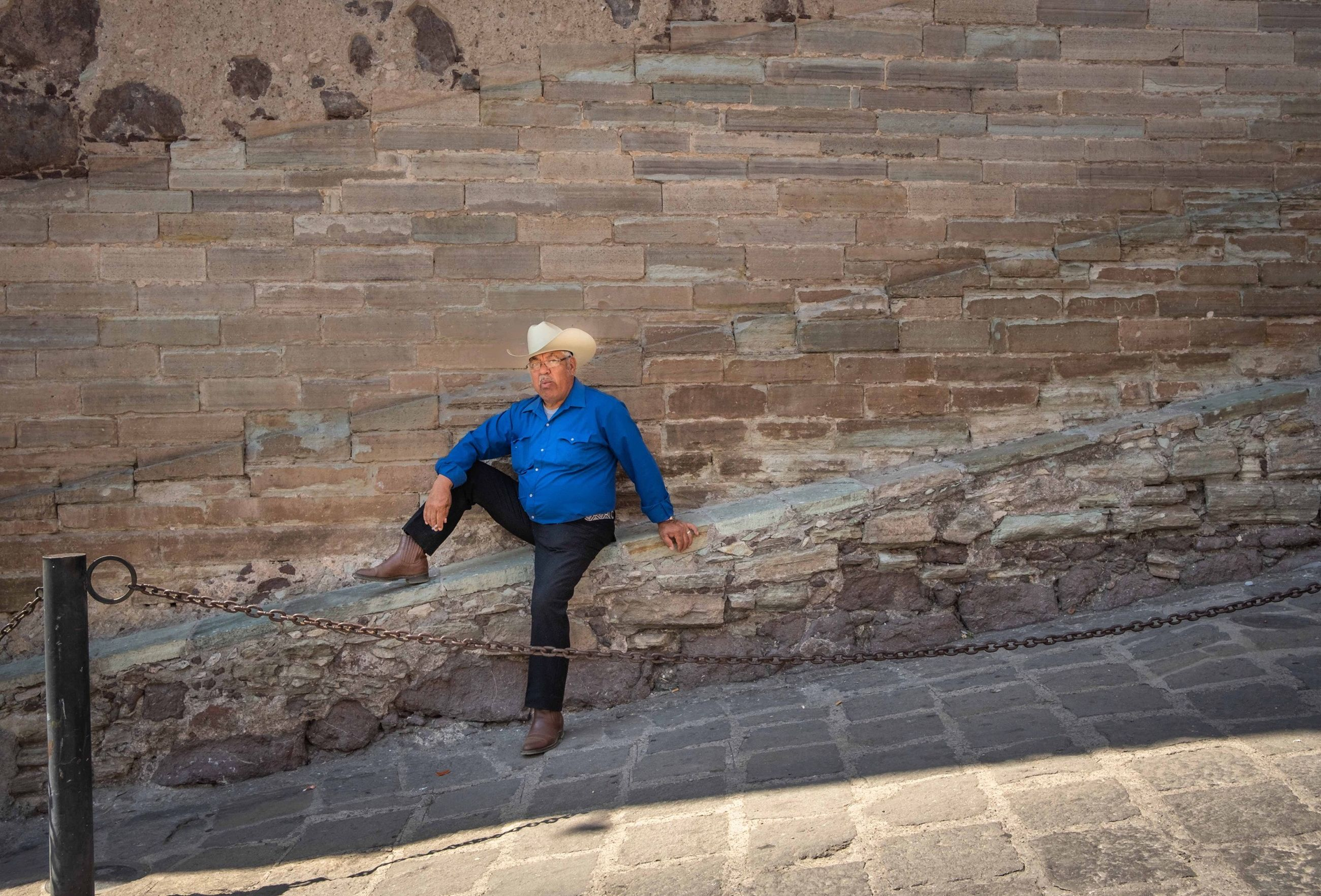 one person, full length, wall, architecture, real people, lifestyles, brick, brick wall, senior adult, leisure activity, front view, staircase, casual clothing, wall - building feature, adult, day, senior women, built structure, outdoors