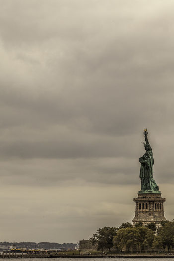 Liberty Sky Cloud - Sky Architecture Travel Destinations Built Structure Travel Statue Tourism Sculpture Nature No People Building Exterior Representation City Female Likeness Human Representation Art And Craft History The Past Freedom Outdoors New York Liberty Island New York City Canon