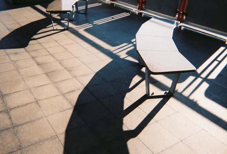 High angle view of empty chair on tiled floor