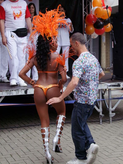 """""""No touching!"""" Paraiso Dancers, Paraiso School of Dancers Brazilian Dance Composition Fun Growth London Paraiso School Of Samba Arts Culture And Entertainment Capital City Celebration Costume Dance Costume Dancers Full Frame Full Length Leisure Activity Lifestyles Man And Woman Dancing Multicolured No Touching Outdoor Photography Performance Real People Togetherness Two People Uk"""