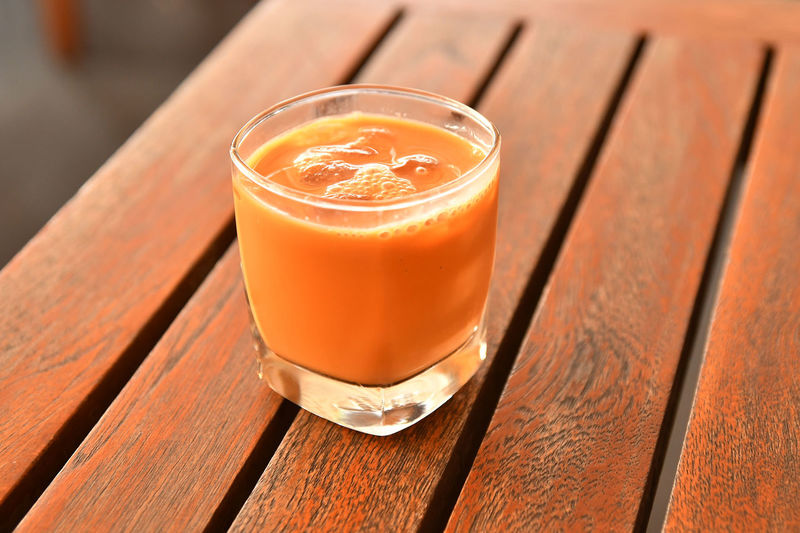 Thai Iced Tea Close-up Day Drink Drinking Glass Focus On Foreground Food Food And Drink Freshness Healthy Eating High Angle View Indoors  No People Ready-to-eat Refreshment Table Thai Iced Tea Wood - Material