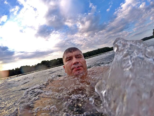 Summer by the lake Leisure Activity Lifestyles Headshot Cloud - Sky Person Season  Portrait Looking At Camera Swimming Water Relaxation Waterfront Enjoyment Sky Shirtless Day Fun Summer Young Adult Splashing Nature Scenics gopro GoPro Hero3+ Gopro Shots Goprophotography