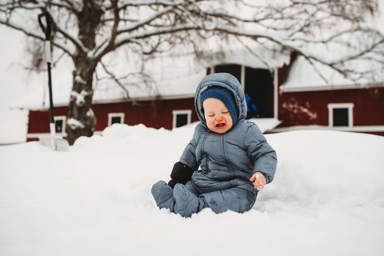 Full length of child in snow during winter