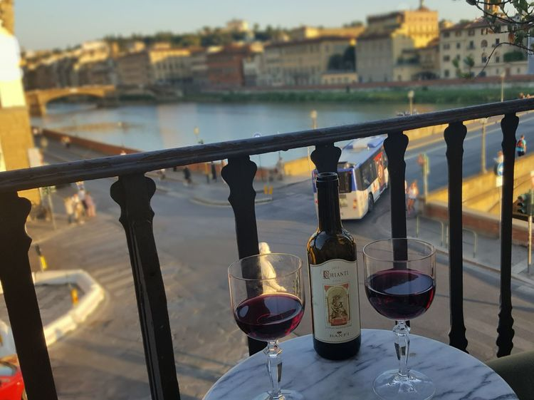 Enjoying the view of Florence from our hotel room Wine Moments Water City Bridge - Man Made Structure River Wine Cityscape Wineglass Wine Bottle Chianti Red Wine River Arno Florence Florence Italy Firenze Hotel Hotel Room Hotel View Hotel Balcony Italy Live For The Story