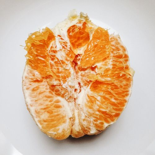 Close-up of fruit over white background