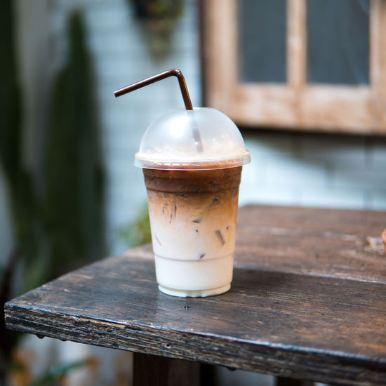 ice coffee Close-up Coffee Coffee - Drink Day Drink Drinking Glass Drinking Straw Focus On Foreground Food Food And Drink Freshness Glass Household Equipment Latte No People Outdoors Railing Refreshment Still Life Straw Table Temptation Wood - Material