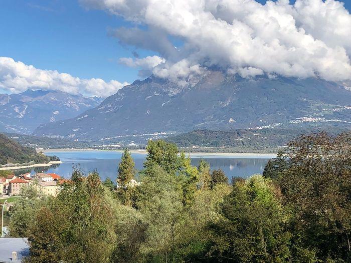 Santa Croce lake Blue Color Lake Cloud - Sky Sky Plant Water Beauty In Nature Mountain Scenics - Nature Nature Tranquil Scene Mountain Range
