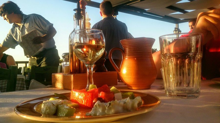 13 july 2014... Holiday in Greece... Greek food, Greek life... Vacations Food And Drink Celebration Wineglass Party - Social Event Alcohol Food People Summer! ♥ Greek Food Greece Wine Greek Wine Jug