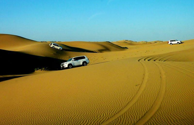 Dune bashing Landscapes Desert Sand Sand Dune Scenics Nature Beauty In Nature Motorsport Landscape Sky Eyem Gallery EyeEm Gallery Desert Safari Light And Shadow Track Traces In The Sand