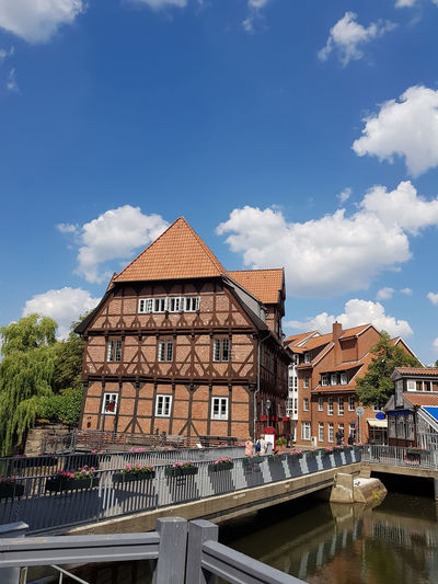Half-timbered red brick houses near the river on the old harbor Lueneburg, Germany Built Structure Architecture Building Exterior Sky Cloud - Sky Nature City Building Day Water No People Residential District Transportation House Outdoors Mode Of Transportation Railing Sunlight Connection Canal Row House #NotYourCliche Love Letter