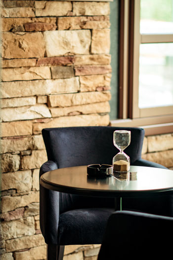 Hourglass On Table At Restaurant