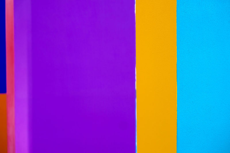 Abstract geometric pattern on concrete wall Abstract Architecture Backgrounds Blue Built Structure Close-up Copy Space Day Full Frame Indoors  Multi Colored No People Pattern Pink Color Purple Striped Variation Vibrant Color Wall - Building Feature Yellow
