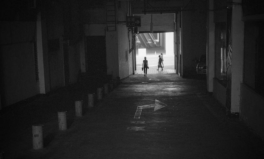 Silhouette Woman Entering Underground Parking Lot