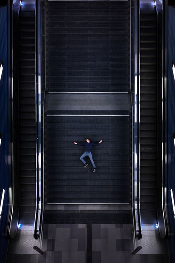 Man lying down on steps