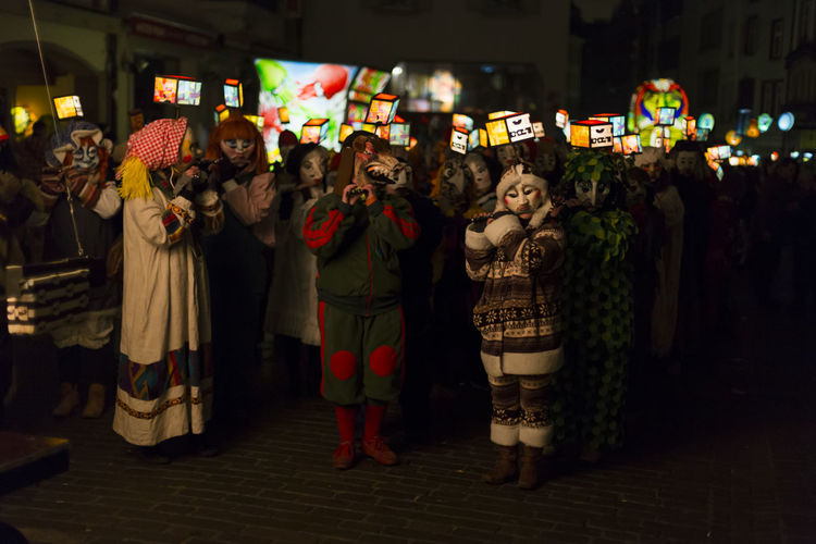 Gerbergasse, Basel, Switzerland - February 19th, 2018. Closeup of carnival participants wearing individual costumes with illuminated mask lanterns. Basel Carnival City City Life City Street Lantern Music Tradition Arts Culture And Entertainment Candid Celebration Colorful Costume Group Of People Large Group Of People Night Outdoors Parade People Piccolo Real People Shrove Tuesday Swiss Switzerland Unesco