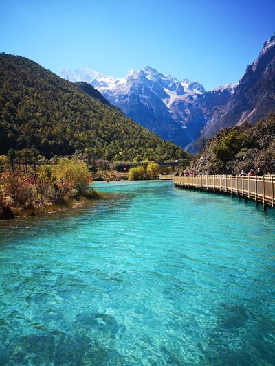 blue lake and snow Tree Water Mountain Snow Blue Clear Sky Pinaceae Sky Mountain Range Landscape Snowcapped Mountain Lakeside Tranquil Scene Calm