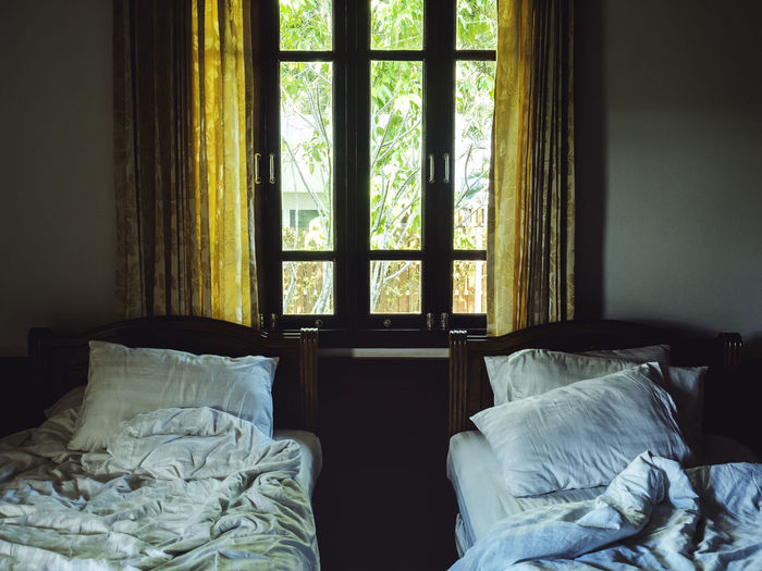 Bed Furniture Bedroom Indoors  Domestic Room Window No People Home Interior Absence Day House Pillow Building Architecture Textile Sheet Messy Linen Sunlight Duvet
