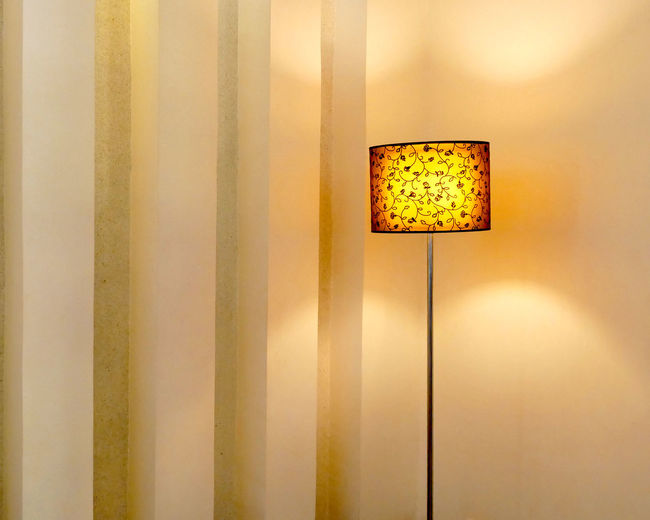 Classic standing lamp with lampshade bright light in living room. Bright Classic Decor Luxurylifestyle  Modern Electric Lamp Electricity  Furniture Glowing Home Interior Illuminated Interior Lampshade Light Lighting Equipment Living Room Luxury Minimalism Standing Lamp Technology Yellow