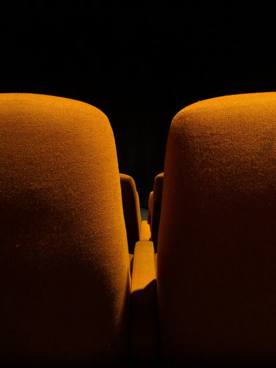 Photogenic cinemas: yellow pt.3 No People Yellow Close-up Indoors  Black Background Google Pixel 2 F/1.8 1/19 Sec Seats Seats Reserved Cinema Seat Symmetry More Than One via Fotofall