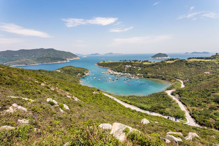 Sunny day in Clear Water Bay Sea Water Blue Hiking Mountain Tree Green Remote Landscape Peak Sky Clouds And Sky HKG ASIA