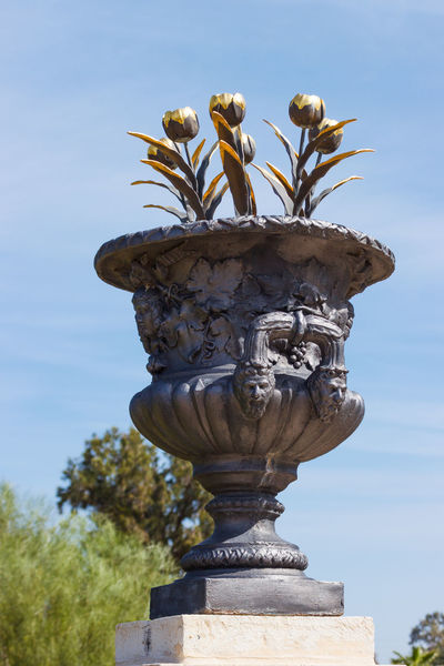 decorative vase with gold tulips in city park Bahai Gardens Ornamental Scenic Vase Acre Art And Craft Blossom Close-up Creativity Day Decorative Famous Place Figured Flower Gilded Israel No People Outdoors Park Sculpture Sky Statue Stone Travel Destinations Tulip