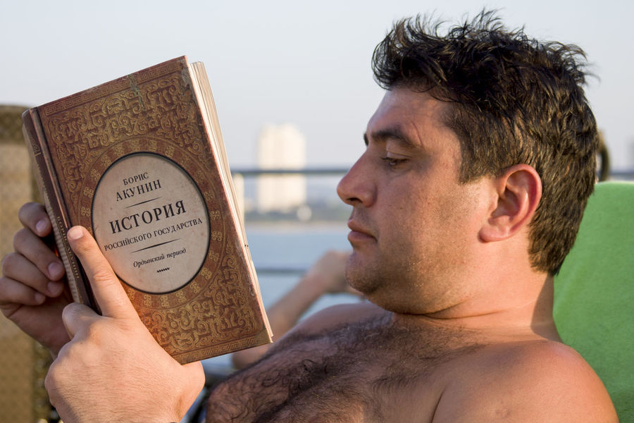Adult Book Lifestyles Macho One Person Only Men Outdoors Reading Reading & Relaxing Reading A Book Shirtless Text TCPM