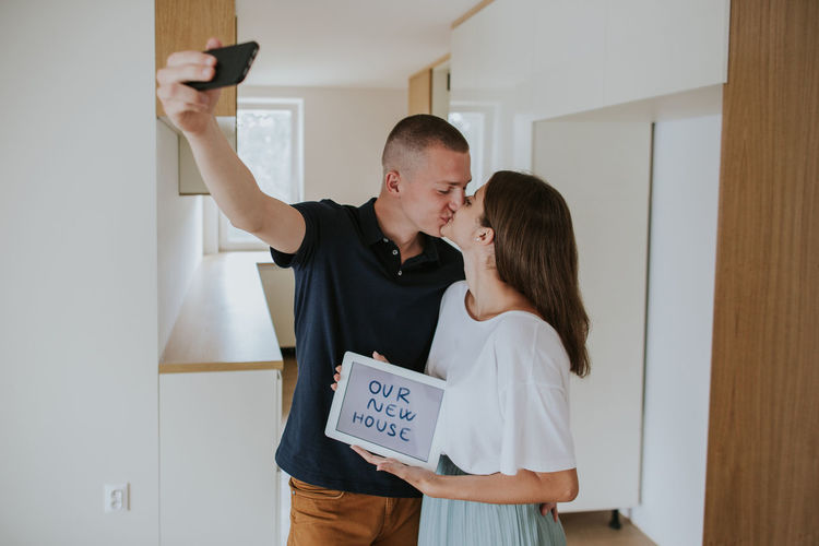 Man and woman using mobile phone