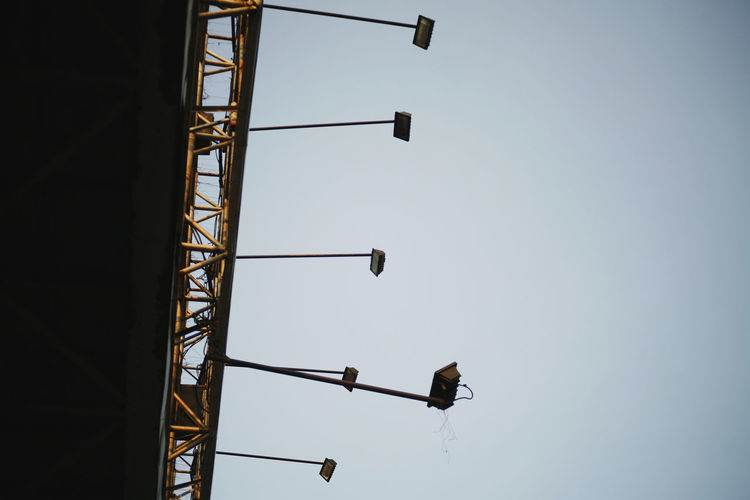 Sky Low Angle View Clear Sky Architecture Built Structure Nature No People Construction Industry Day Lighting Equipment Outdoors Copy Space Metal Building Exterior Street Light Tall - High Construction Site Street Building Machinery