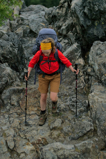 female hiker walking on a trail Alpine Backpacking Camping Expedition Freedom Hiking Nature Travel Trekking Woman Active Activity Adventure Backpack Boot Challenge Climbing Detail Effort Extreme Sports Female Full Length Healthy Lifestyle Hobbies Legs Leisure Activity Mountain Mountain Range Nature One Person Outdoors People person Protection Rock Rock - Object Rock Climbing Rock Formation Safety Solid Sport Trek Walking
