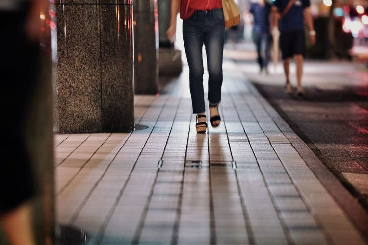 Low section of women walking on floor