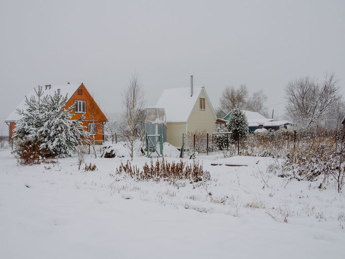 Snow Winter Cold Temperature Building Exterior Architecture Built Structure Building House Residential District Nature White Color Field Tree Covering Plant No People Sky Day Land Outdoors