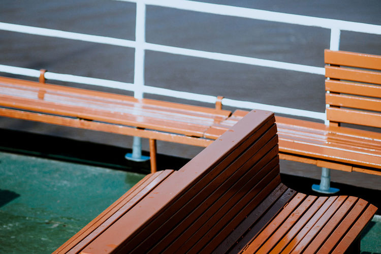 High angle view of empty seats on boat deck