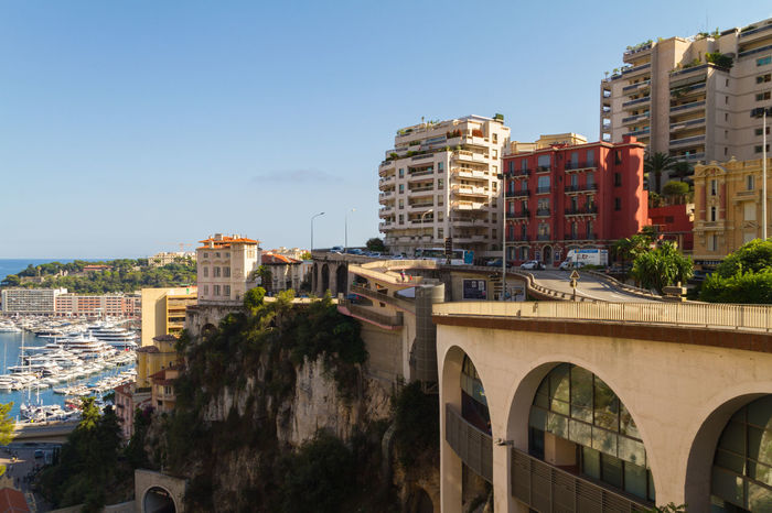 Monaco city view from Monaco Train Station Apartment Architecture Building Exterior Building Terrace City City Life Cityscape Clear Sky Day Downtown District House Marine Monaco Monte Carlo No People Outdoors Residential Building Roof Sky Train Station Travel Destinations Urban Road Urban Skyline Yatch