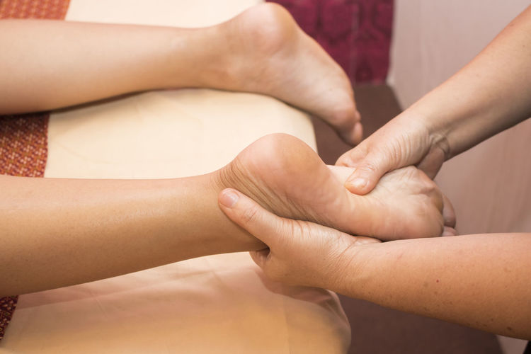 Foot massage Adult Body Part Bonding Finger Friendship Group Of People Hand Human Body Part Human Foot Human Hand Human Leg Human Limb Indoors  Lifestyles Limb Low Section Midsection People Real People Togetherness Women