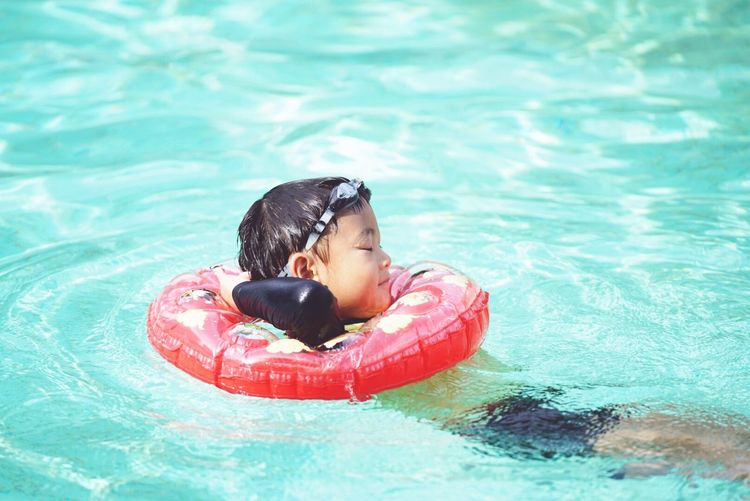Side View Of Boy Swimming In Pool