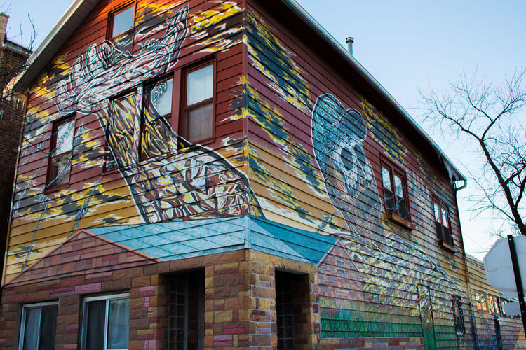 A Pilsen-native uses his own home as a canvas and mode of communication for a neighborhood-wide discussion. Architecture Building Exterior Chicago Façade Graffiti Multi Colored Pilsen Residential Building Residential Structure Sky Street Art Colour Of Life