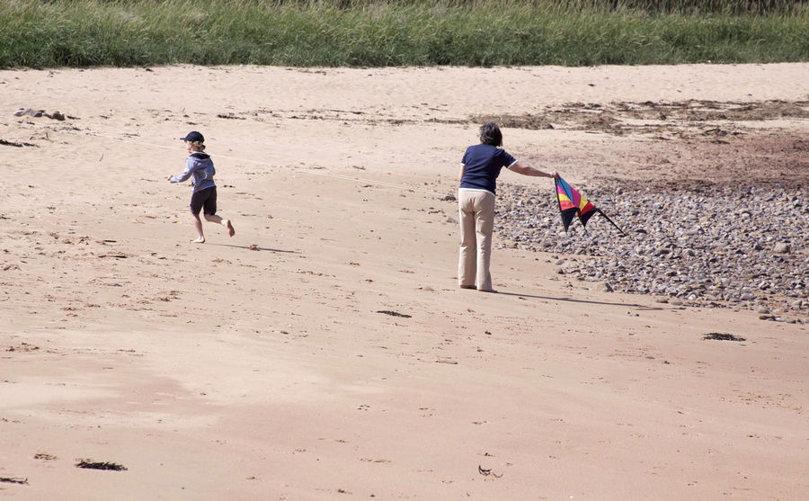 Boys Carrying Casual Clothing Child Childhood Children Day Elementary Age Enjoyment Full Length Fun Girls Innocence Leisure Activity Lifestyles Nature Outdoors Playing Sand Sibling Tourism Tourist Tranquility Vacations Walking