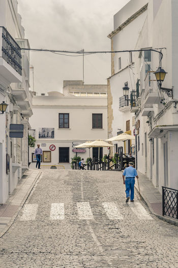 Architecture Building Exterior Built Structure Cloud - Sky Day Full Length Man In Blue 🔵⚪⚫ Men One Person Outdoors People Quiet Spanish Streets Real People Sky The Way Forward Travel Walking