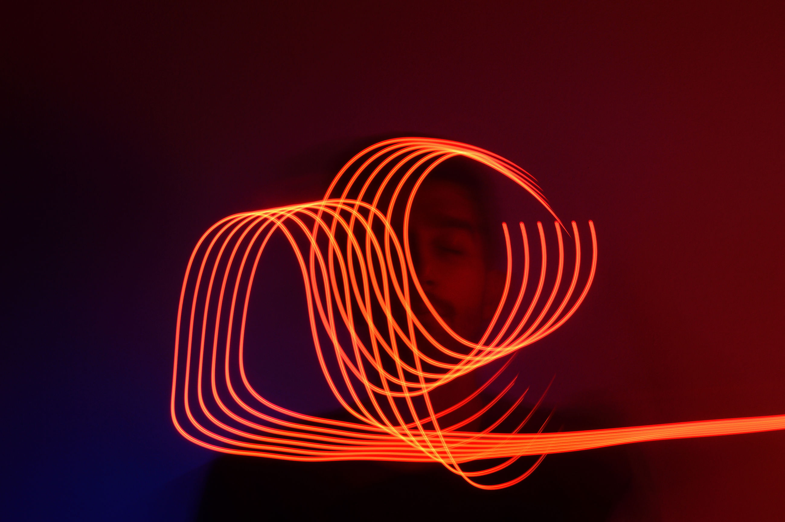 long exposure, light painting, illuminated, motion, pattern, glowing, blurred motion, night, light trail, red, orange color, no people, studio shot, creativity, spiral, indoors, copy space, abstract, close-up, light - natural phenomenon, wire wool