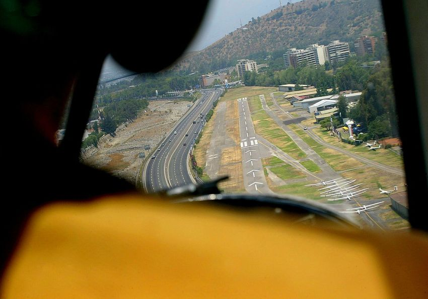 Aerial Shot Final approach to the runway of the Aero Club of Vitacura, seen from the passenger seat of a towing glider plane. Lookingdown Color Photography On The Plane ✈ Glider On The Way