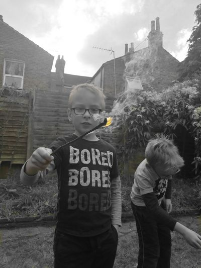 Real People Child Outdoors Danger Togetherness Day Fire Borred Doni Kids Children Boy Boy Playing With Fire Flame Flame In Hands Fire In Hands Welcome To Black Resist