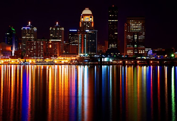 Reflection Of Illuminated Colorful Light On Ohio River Against Buildings At Night