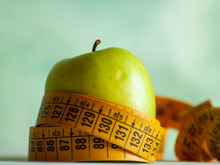 Apple Diet Measuring Measuring Tape Medicine Obesity Slim Apple Apple - Fruit Close-up Communication Diet Food Dieting Fiber Focus On Foreground Food Food And Drink Freshness Fruit Granny Smith Apple Green Color Health Health Care Healthcare And Medicine Healthy Healthy Eating Indoors  Lifestyles No People Number Nutrition Nutritious Organic Organic Food Ripe Slimdown Still Life Studio Shot Tape Measure Text Thin Vitamin Wellbeing Western Script