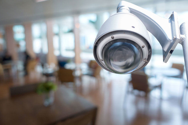 Close-Up Of Security Camera At Coffee Shop