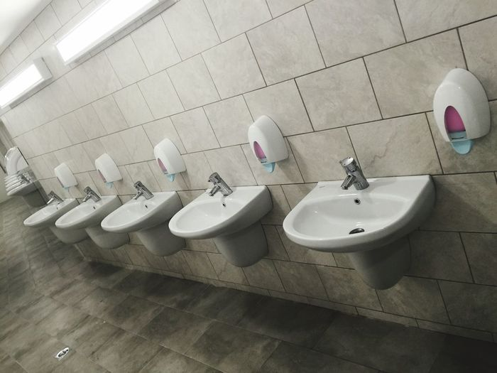 Bathroom sinks and soap dispensers in restroom