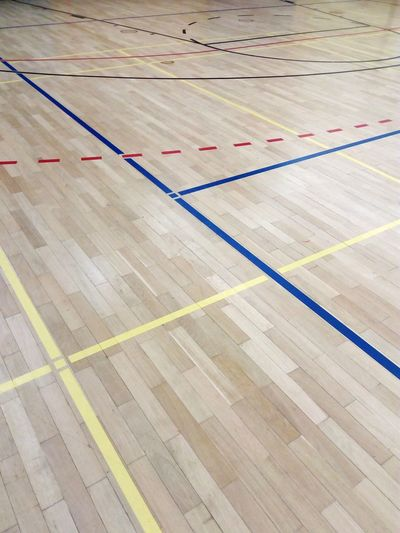 playing field limit lines on parquet in a gym sports center Parquet Wooden Paneling LINE Limit Playing Field Field Limit Field Line Gym Sports Center Indoor Sports Ball Sports Sports Outdoors No People Day Supermarket