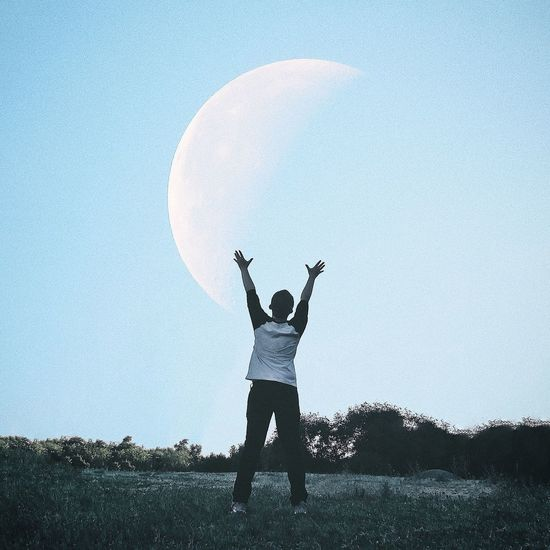 Arms Raised Human Arm One Person Sky Outdoors Clear Sky Blue Silhouette Real People Field Standing Leisure Activity Full Length Nature Lifestyles Day Moon Men Human Body Part Grass